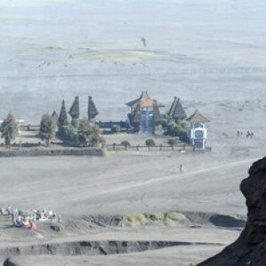 man sitting on a hill of Mt.Bromo