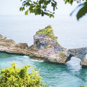 Beautiful Rock Arch Island in the Sea at Atuh Beach in Nusa Penida